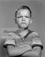846-05646483 © ClassicStock / Masterfile Model Release: Yes Property Release: No 1960s PORTRAIT POUTING ANGRY BOY ARMS FOLDED AGAINST CHEST STRIPED SHIRT